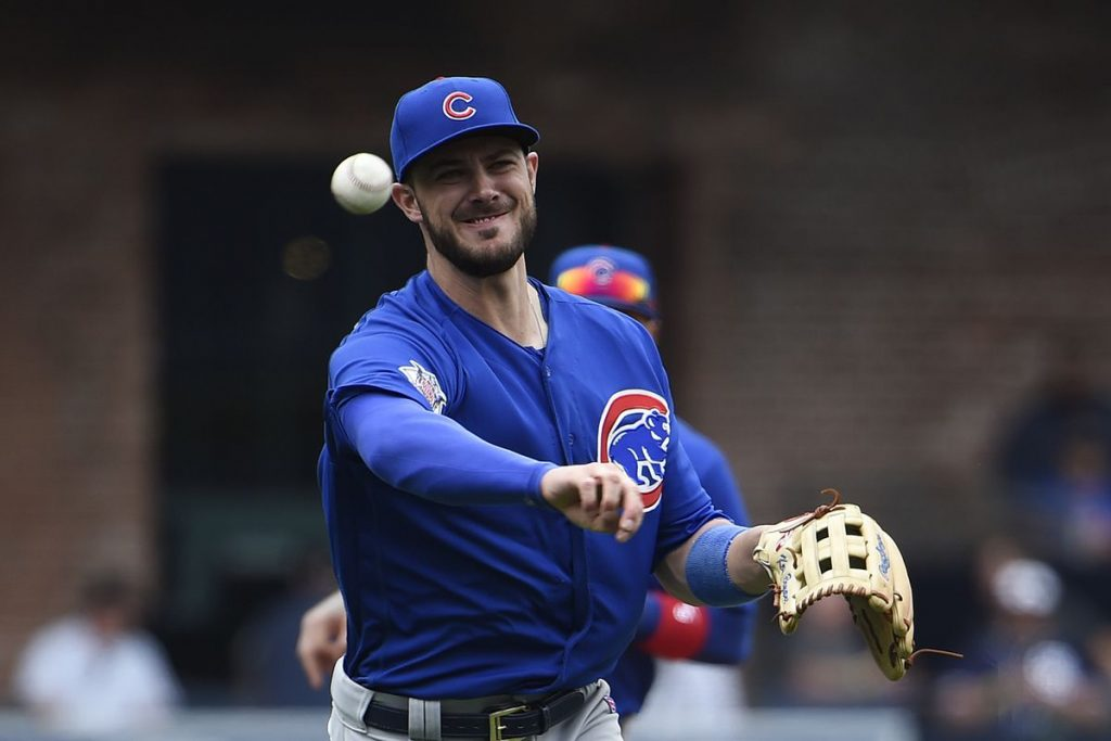 Kris Bryant throwing a baseball